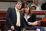 Nevada Assembly Majority Leader Marcus Conklin, D-Las Vegas, and Assemblywoman Marilyn Kirkpatrick, D-North Las Vegas, talk on the Assembly floor on April 18, 2011, at the Legislature in Carson City, Nev. .Photo by Cathleen Allison