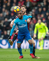 Alexandre Lacazette of Arsenal & Simon Francis of AFC Bournemouth during the Premier League match between Bournemouth and Arsenal at the Goldsands Stadium, Bournemouth, England on 14 January 2018. Photo by Andy Rowland.