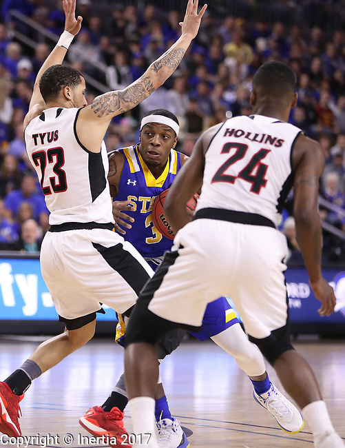 SIOUX FALLS, SD: MARCH 7: Chris Howell #3 of South Dakota State drives toward Omaha defenders Marcus Thus #23 and Tra-Deon Hollins #24 during the Men's Summit League Basketball Championship Game on March 7, 2017 at the Denny Sanford Premier Center in Sioux Falls, SD. (Photo by Dick Carlson/Inertia)