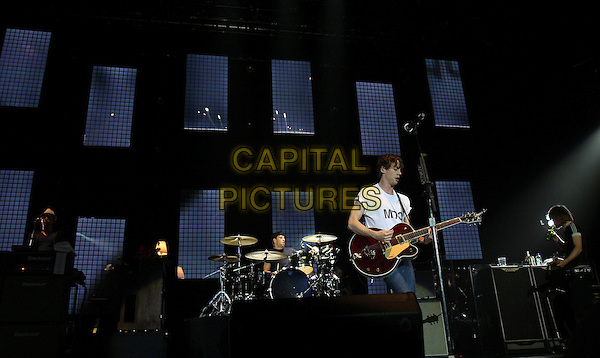 RAZORLIGHT - JOHNNY BORRELL.Indie rock band Razorlight perform live at the O2 Arena in London, England, UK, May 7th 2009..concert music gig on stage performing half length white t-shirt skinny jeans.microphone singing playing guitar band  group.CAP/MAR.©Martin Harris/Capital Pictures