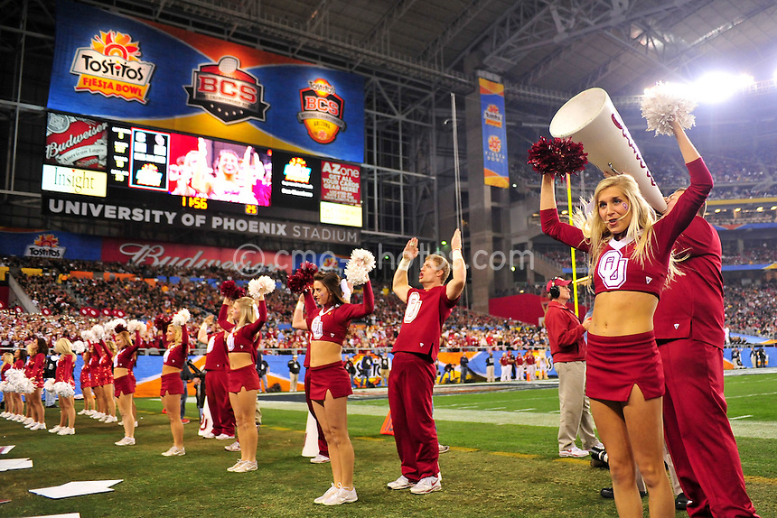 Jan 1, 2011; Glendale, AZ, USA; The Oklahoma Sooners cheerleaders perform on the sidelines in the 3rd quarter of the 2011 Fiesta Bowl against the Connecticut Huskies at University of Phoenix Stadium.  The Sooners won the game 48-20.