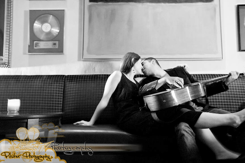 Amanda Adler and Derrick Paladino during an engagement session on Sunday, August 14, 2011, at the Hard Rock Hotel® at Universal Orlando® in Orlando, Florida. They rocked out with a couple guitars (Chad Pilster for Pilster Photography http://www.PilsterPhotography.net)