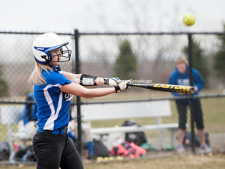 LITCHFIELD, CT-14 April 2015-041415EC10-  Lewis Mills' Julia Arel hits a pop-up Tuesday in Litchfield. The Cowboys caught it for an out. Erin Covey Republican-American