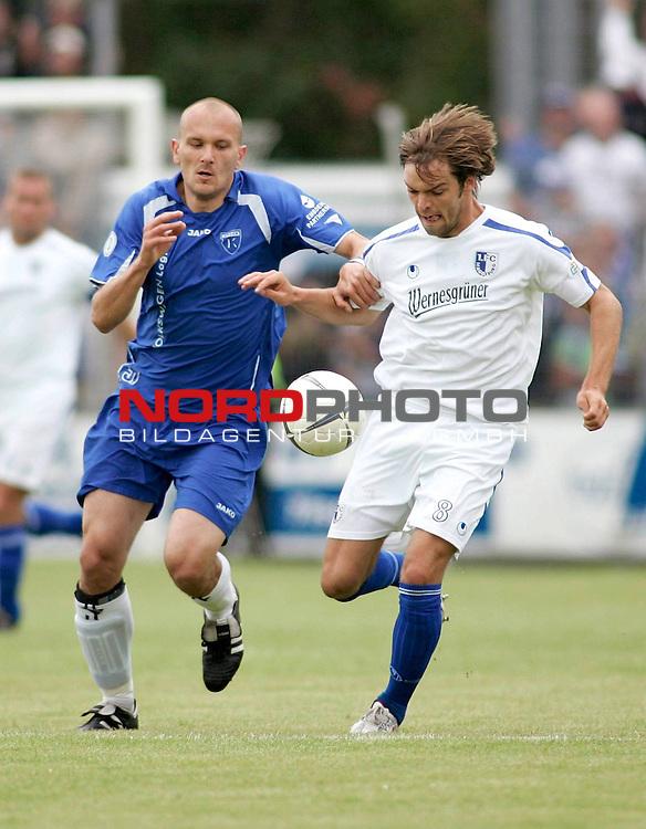 RLN 2006/2007 - 33.Spieltag R&uuml;ckrunde <br /> <br /> Kickers Emden - 1. FC Magdeburg<br /> <br /> Rudolf Zedi (Kickers) - Andy M&uuml;ller (r.)<br /> <br /> <br /> <br /> Foto &copy; nph /  nordphoto *** Local Caption *** Foto ist honorarpflichtig! zzgl. gesetzl. MwSt.<br /> <br /> <br /> <br /> Belegexemplar erforderlich