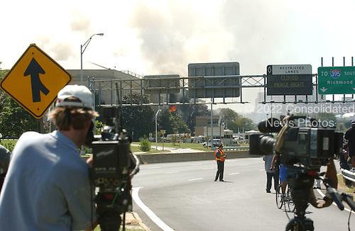 Washington, DC - September 11, 2001 -- TV cameras aimed at the side of the Pentagon that is still on fire following the terrorist attack on Tuesday, September 11, 2001..Credit: Ron Sachs / CNP