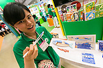 An booth assistant shows a ''Manner fish''  of EYEUP co., LTD at the International Tokyo Toy Show 2016 in Tokyo Big Sight on June 9, 2016, Tokyo, Japan. The annual exhibition showcases some 35,000 toys from 160 toy makers from Japan and overseas. The show runs to June 12th and organisers expect to attract 160,000 visitors. (Photo by Rodrigo Reyes Marin/AFLO)