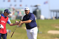Shane Lowry (IRL) and caddy Dermot Byrne at the 17th green during Thursday's Round 1 of the 118th U.S. Open Championship 2018, held at Shinnecock Hills Club, Southampton, New Jersey, USA. 14th June 2018.<br /> Picture: Eoin Clarke | Golffile<br /> <br /> <br /> All photos usage must carry mandatory copyright credit (&copy; Golffile | Eoin Clarke)