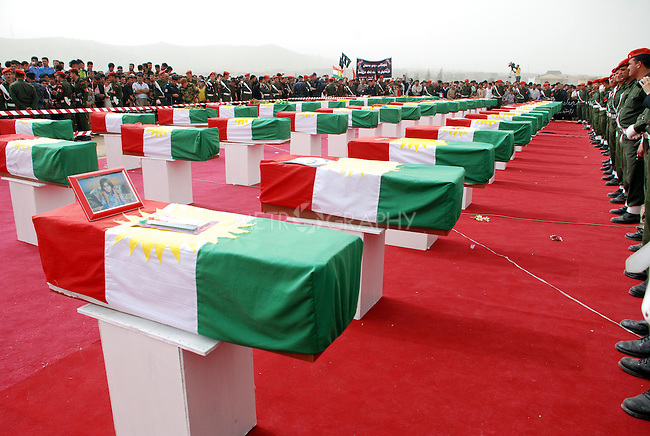 CHAMCHAMAL, IRAQ: Coffins are laid out at the funeral ceremony of 104 Kurds discovered in a mass grave...On April 15, 2010, Iraqi Kurds held a ceremony to honor the 102 children and 2 pregnant women discovered in a mass grave near the town of Dibis.  They are believed to have been killed in the 1988 Anfal genocidal campaign against Iraq's Kurds.