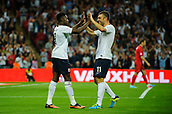 06.09.2013 London, England. England Forward Danny Welbeck (Manchester United) celebrates with Forward Rickie Lambert (Southampton) after scoring the 4th goal during the second half of the 2014 FIFA World Cup Qualifier between England and Moldova at Wembley Stadium.