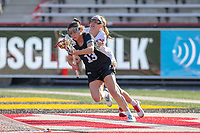 College Park, MD - April 27, 2019: John Hopkins Bluejays Keegan Barger (13) runs pass a Maryland Terrapins defender during the game between John Hopkins and Maryland at  Capital One Field at Maryland Stadium in College Park, MD.  (Photo by Elliott Brown/Media Images International)
