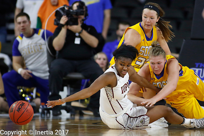 SIOUX FALLS, SD: MARCH 6: Danielle Lawrence #14 of IUPUI reaches for a loose ball with Clarissa Ober #21 of South Dakota State.  In the background is Sydney Palmer #32 of South Dakota State. during the Summit League Basketball Championship on March 6, 2017 at the Denny Sanford Premier Center in Sioux Falls, SD. (Photo by Dick Carlson/Inertia)