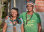Anacelia Barros da Costa (left) and Pedro Mura are leaders of the Nacoes Indigenas neighborhood in Manaus, Brazil. The neighborhood is home to members of more than a dozen indigenous groups, many of whose members have migrated to the city in recent years from their homes in the Amazon forest.
