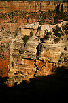 Rock wall extends into southern rim of the Grand Canyon at sundown.<br />