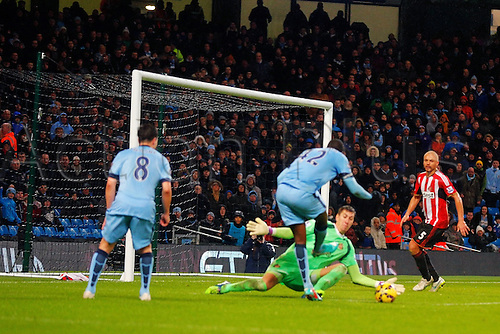 01.01.2015.  Manchester, England. Barclays Premier League. Manchester City versus Sunderland. Sunderland goalkeeper Costel Pantilimon saves at the feet of Manchester City midfielder Yaya Toure