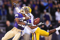 Sept. 5, 2009; Seattle, WA, USA; Washington Huskies wide receiver (82) Jordan Polk attempts to catch a pass as he is hit by LSU Tigers cornerback (15) Brandon Taylor in the fourth quarter at Husky Stadium. Taylor was called for pass interference. LSU defeated Washington 31-23. Mandatory Credit: Mark J. Rebilas-