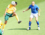 26 June 2006: Tim Cahill (AUS) (4) heads away the cross intended for Alessandro Del Piero (ITA) (7). Italy (1st place in Group E) defeated Australia (2nd place in Group F) 1-0 at Fritz-Walter Stadion in Kaiserslautern, Germany in match 53, a Round of 16 game, in the 2006 FIFA World Cup.