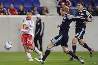 Connor Chinn (25) of the New York Red Bulls takes a shot past the defense of Pat Phelan (28) of the New England Revolution. The New York Red Bulls defeated the New England Revolution 3-0 during a U. S. Open Cup qualifier round match at Red Bull Arena in Harrison, NJ, on May 12, 2010.