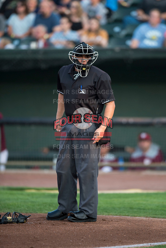 Home plate umpire Ethan McCranie during a Pioneer League game between the Great Falls Voyagers and Idaho Falls Chukars at Melaleuca Field on August 18, 2018 in Idaho Falls, Idaho. The Idaho Falls Chukars defeated the Great Falls Voyagers by a score of 6-5. (Zachary Lucy/Four Seam Images)