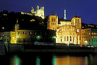 France, Lyon, Rhone-Alpes, Europe, Cathedral Saint Jean (below) and Basilique Notre Dame de Fourviere (above) illuminated at night along the Saone River in Lyon.
