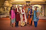 © Joel Goodman . 18 May 2013 . Gita Bhavan Hindu Temple , Withington Road , Whalley Range , Manchester . L-R Dr Poonam Kakkar , Dr Ravi Kakkar , Acharya (instructor) Shyam Sunder Sharma , Professor Nawal Prinja , Jiwan Singh Dhanik , Mrs Kusum Vyas PHD , Mrs Sunita Prinja . Commemorative service to celebrate the handover of the Green Kumbh Yatra (green journey pot or environmental pilgrimage) at the Gita Bhavan Hindu Temple in Manchester . The pot has travelled to the Maha Kumbh Mela , Kenya , Nepal and the Western Wall in Jerusalem along the way . At every place of rest an environmental action must be taken to reflect the pot's environmental significance . It's due to travel to Leicester and feature in an outdoor procession in London on 24th May 2013 . Photo credit : Joel Goodman