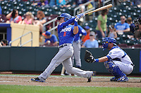 Matt Reynolds #5 of the Las  Vegas 51s swings against the Omaha Storm Chasers at Werner Park on August 17, 2014 in Omaha, Nebraska. The Storm Chasers  won 4-0.   (Dennis Hubbard/Four Seam Images)