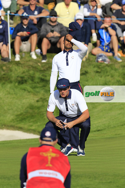 Bryson Dechambeau and Tiger Woods (Team USA) on the 11th green during Saturday's Foursomes Matches at the 2018 Ryder Cup 2018, Le Golf National, Ile-de-France, France. 29/09/2018.<br /> Picture Eoin Clarke / Golffile.ie<br /> <br /> All photo usage must carry mandatory copyright credit (© Golffile | Eoin Clarke)