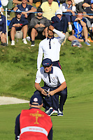 Bryson Dechambeau and Tiger Woods (Team USA) on the 11th green during Saturday's Foursomes Matches at the 2018 Ryder Cup 2018, Le Golf National, Ile-de-France, France. 29/09/2018.<br /> Picture Eoin Clarke / Golffile.ie<br /> <br /> All photo usage must carry mandatory copyright credit (&copy; Golffile | Eoin Clarke)