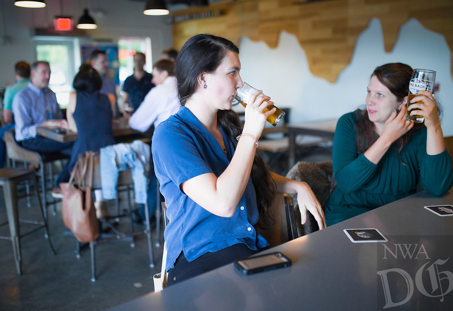 NWA Democrat-Gazette/CHARLIE KAIJO Katie Sozansky of Fayetteville and Chelsea Miller of Bentonville (from left) drink beers, Thursday, August 8, 2019 at the Bike Rack Brewing in Bentonville.<br /> <br /> Bike Rack Brewing is distributing into Little Rock now.