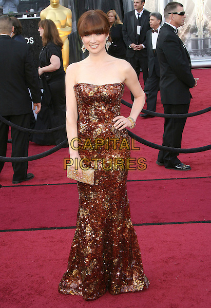 Ellie Kemper.84th Annual Academy Awards held at the Hollywood & Highland Center, Hollywood, California, USA..February 26th, 2012.oscars full length gold brown sequins sequined strapless hand on hip dress clutch bag.CAP/ADM.©AdMedia/Capital Pictures.
