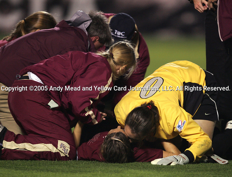 2 December 2005: FSU's Melissa Samokishyn (center) is comforted by Ali Mims (0) after breaking her leg. The UCLA Bruins defeated the Florida State Seminoles 4-0 in their NCAA Division I Women's College Cup semifinal at Aggie Soccer Stadium in College Station, TX.