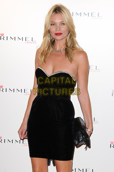 Kate Moss.The Rimmel London party, Battersea Power Station, London, England..September 15th, 2011.half red lipstick necklace length black strapless dress diamante trim clutch bag .CAP/CJ.©Chris Joseph/Capital Pictures.