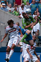 Nate Jaqua (r) of the Seattle Sounders goes up for a header against Baggio Husidic (9) of the Chicago Fire in the match at the XBox Pitch at Quest Field on July 25, 2009. The Sounders and Fire played to a 0-0 draw.