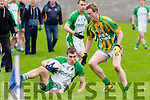 Ballydonoghue captain Tommy Kennelly slips to the ground with Colm Ó Gealbháin Lispole defender surrounds him when the side met at kern's O'Rahilly's GAA pitch, Tralee last Sunday