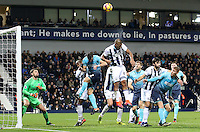 Salomon Rondon of West Bromwich Albion heads the ball clear as Swansea take a corner during the Premier League match between West Bromwich Albion and Swansea City at The Hawthorns, England, UK. Wednesday 14 December 2016