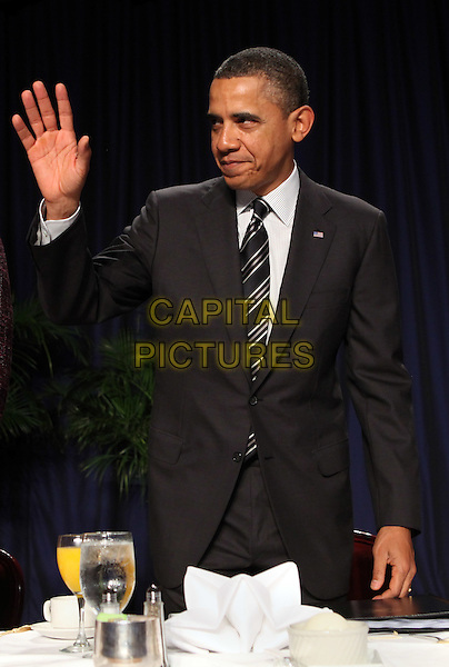 United States President Barack Obama  at the National Prayer Breakfast in Washington, DC, February 2, 2012. .half length hand waving .CAP/ADM/CNP/CK.©Chris Kleponis/Pool/CNP/AdMedia/Capital Pictures.