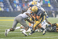 Annapolis, MD - September 8, 2018: Navy Midshipmen fullback Anthony Gargiulo (38) gets tackled during the game between Memphis and Navy at  Navy-Marine Corps Memorial Stadium in Annapolis, MD.   (Photo by Elliott Brown/Media Images International)
