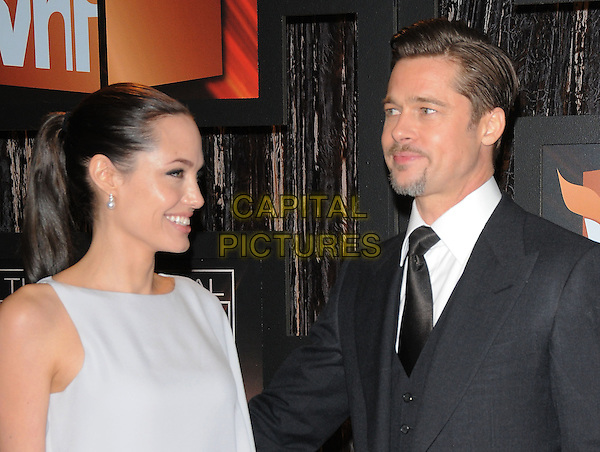 ANGELINA JOLIE & BRAD PITT.The 14th Annual Critics Choice Awards held at The Santa Monica Civic Center in Santa Monica, California, USA. .January 8th, 2009.half length black tie suit white dress one shoulder sleeve pale grey gray couple goatee facial hair profile ponytail .CAP/DVS.©Debbie VanStory/Capital Pictures.