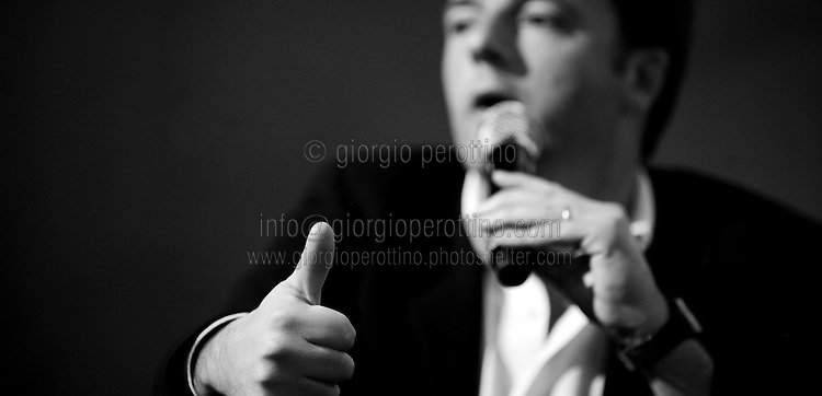 Matteo Renzi gestures and gives a thumb up during a political campaign convention for the Partito Democratico's primary elections -Italian left wing Party - in Turin, December 6, 2013.