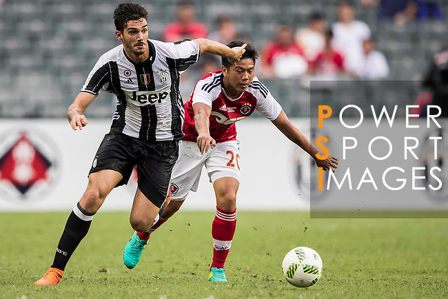Juventus' player Giulio Parodi contests the ball against South China's player Lau Cheuk Hin during the South China vs Juventus match of the AET International Challenge Cup on 30 July 2016 at Hong Kong Stadium, in Hong Kong, China.  Photo by Marcio Machado / Power Sport Images