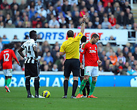 Saturday 17 November 2012<br /> Pictured: Itay Shchter of Swansea (R) sees a yellow card by match referee Phil Dowd (C).<br /> Re: Barclay's Premier League, Newcastle United v Swansea City FC at St James' Park, Newcastle Upon Tyne, UK.