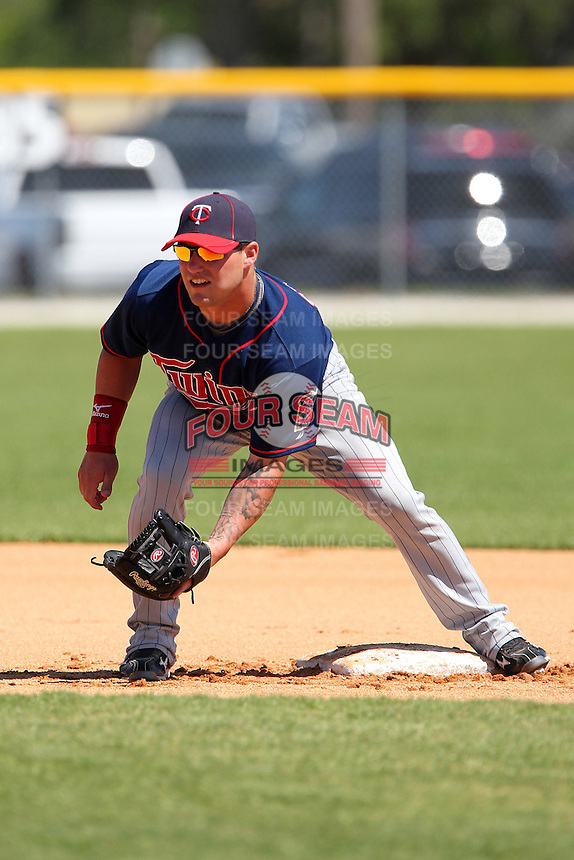 Minnesota Twins shortstop Tyler Grimes #11 during practice before a minor league spring training game against the Baltimore Orioles at the Buck O'Neil Complex on March 19, 2012 in Sarasota, Florida.  (Mike Janes/Four Seam Images)
