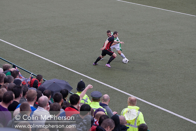 Bohemians forward Mark Quigleytaking on an opponent at Park Hall Stadium, Oswestry during his team's Champions League 2nd qualifying round 2nd leg game away to The New Saints. Despite leading 1-0 from the first leg, the Dublin club went out following their 4-0 defeat by the Welsh champions. The match was the first-ever Champions League match in the UK played on an artificial pitch and was staged at the Welsh Premier League's ground which was located over the border in England.