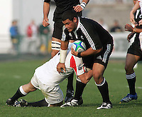 England's Nathan Catt tackles New Zealand tight head Ben Ageaki during the Division A U19 World Championship match at Ravenhill, Belfast.