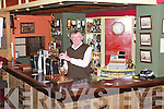 Pat Herbert working behind his Bar, Herberts Kilflynn..