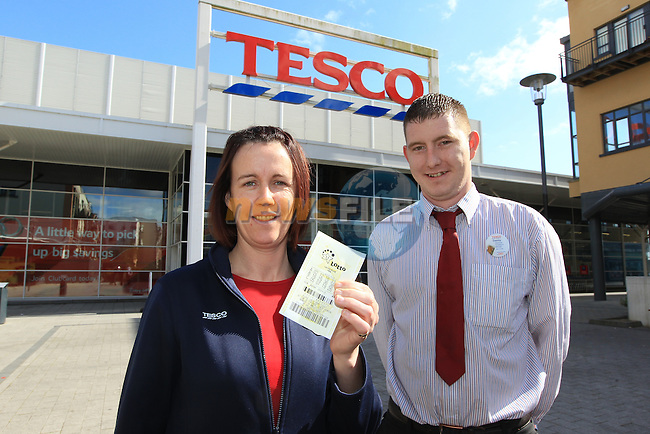 Danny Gorman Manager and Paula Byrne who sold the winning ticket in the Tesco Store  in the Narrow ways in Bettystown where one of the lotto winning tickets was sold yesterday..Picture Fran Caffrey www.newsfile.ie..