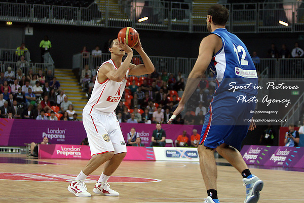 Jianlian Yi (China) and Nenad Krstic (Serbia) in action. Serbia v China. The London International Basketball Invitational. London Prepares for Olympics 2012. Basketball Arena, Olympic Park. London. 17/08/2011. MANDATORY Credit Sportinpictures/Paul Chesterton - NO UNAUTHORISED USE - 07837 394578.