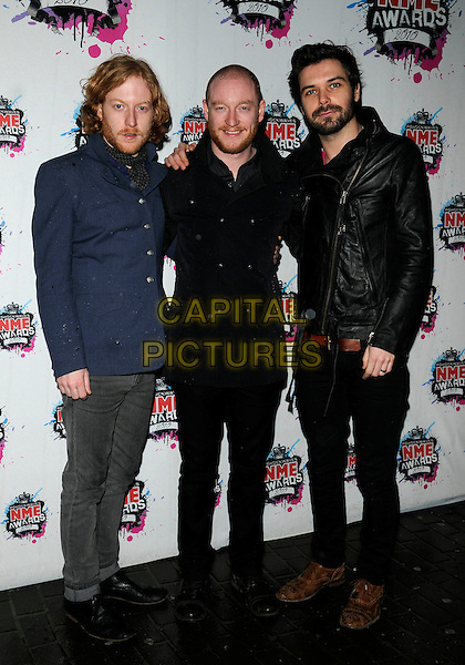 BIFFY CLYRO - Ben Johnston, James Johnston & Simon Neil.The Shockwaves NME Awards 2010 held at Brixton Academy, London, England. .February 24th, 2010.full length black jacket blue shirt beard facial hair leather jeans denim .CAP/CAN.©Can Nguyen/Capital Pictures.