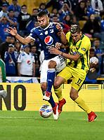 BOGOTA - COLOMBIA - 01 – 04 - 2018: Andres Cadavid (Izq.) jugador de Millonarios disputa el balón con Michael Rangel (Der.) jugador de Atletico Bucaramanga, durante partido de la fecha 12 entre Millonarios y Atletico Bucaramanga, por la Liga Aguila I 2018, jugado en el estadio Nemesio Camacho El Campin de la ciudad de Bogota. / Andres Cadavid (L) player of Millonarios vies for the ball with Michael Rangel (R) player of Atletico Bucaramanga, during a match of the 12th date between Millonarios and Atletico Bucaramanga, for the Liga Aguila I 2018 played at the Nemesio Camacho El Campin Stadium in Bogota city, Photo: VizzorImage / Luis Ramirez / Staff.
