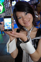 "A promotion girl for software maker Hudson holding software for i-pods and i-phones called ""Catch the Egg""."