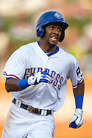Round Rock Express outfielder Julio Borbon #20 rounds third base on his way home during the Pacific Coast League baseball game against the Sacramento River Cats on May 24, 2012 at the Dell Diamond in Round Rock, Texas. The Express defeated the River Cats 5-3. (Andrew Woolley/Four Seam Images).